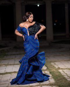 Tboss Oozes Elegance In Ama Array's Blue Off-shoulder Ankara Maxi Dress