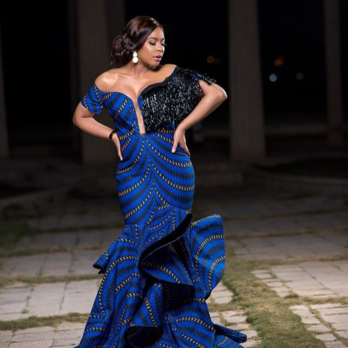 Tboss Oozes Elegance In Ama Array's Blue Off-shoulder Ankara Maxi Dress