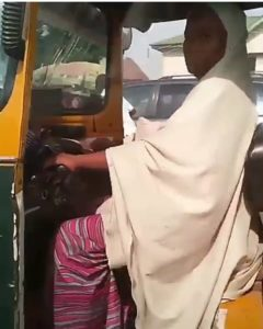 (Video) Hijabi Lady Spotted Riding Keke Napep