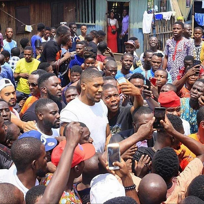 Sons Of The Soil! Anthony Joshua Poses With Lagos Boys On His Visit To Nigeria