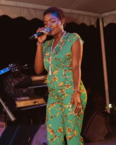 Simi Confirms Pregnancy As She Shows Off Her Growing Baby Bump In Beautiful Floral Jumpsuit
