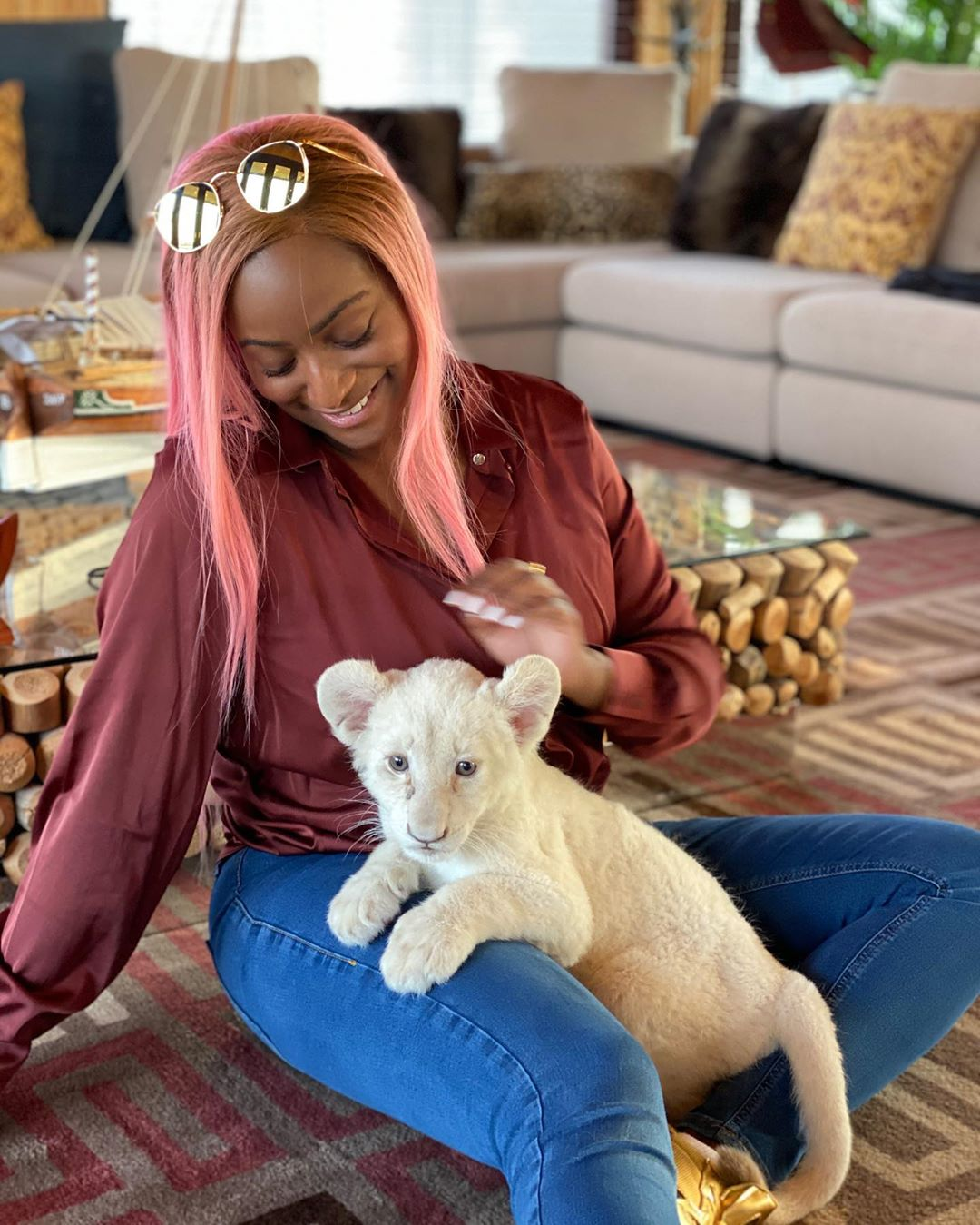 """""""I've Always Wanted To Be A Mother"""" – DJ Cuppy As She Feeds Baby Lion"""